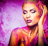 Woman with conceptual colourful body art Royalty Free Stock Photos