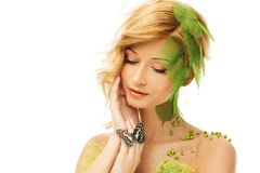 Woman in conceptual spring costume Stock Photos