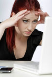 Woman concerned at work Stock Photo