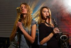 Woman at concert. Woman with saxophone on music concert Royalty Free Stock Photos