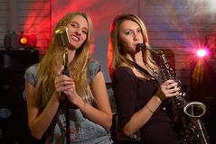 Woman at concert. Woman with saxophone on music concert Stock Images