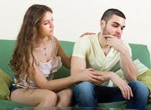 Woman concoling depressed man Stock Photos