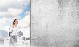 Woman and concrete empty banner Royalty Free Stock Images