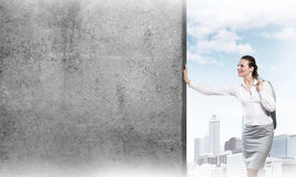 Woman and concrete empty banner Royalty Free Stock Image