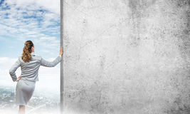 Woman and concrete empty banner Stock Photo