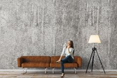 Woman in concrete living room