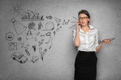 Woman on concrete wall with business sketches Stock Image