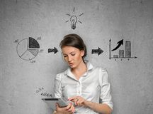 Woman on concrete wall with business sketches Stock Photo