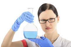 Woman conducting a chemical experiment Royalty Free Stock Image