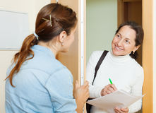 Woman conducting a survey among residents royalty free stock photography