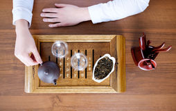 Woman conducting tea ceremony Royalty Free Stock Images