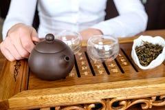 Woman conducting tea ceremony Stock Photo
