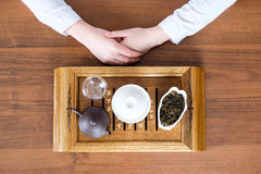 Woman conducting tea ceremony Stock Photography