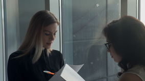 A woman conducts a questionnaire from a job applicant for a job. stock footage