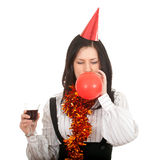 Woman in cone hat with glass of red wine Stock Photo