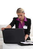 Woman at a conference. Womanwitha laptop at a conference Royalty Free Stock Photo