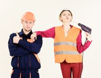 Woman with confident face in helmet, hard hat holds drill. Near mouth, lips, white background. Confident builder, repairman shows thumb up gesture near lady royalty free stock photo