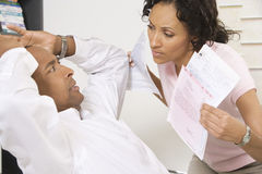 Woman Confronting Man About Bills. African American women confronting men about bills Royalty Free Stock Photography