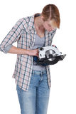 Woman confused by circular saw Royalty Free Stock Photography