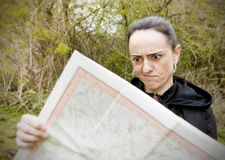 Woman confused looking at map Stock Images
