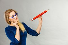 Free Woman Confused Thinking, Big Pencil In Hand Royalty Free Stock Photography - 108084027