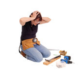 Woman confused what she did with tools. Royalty Free Stock Image