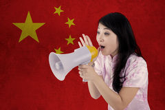 Woman congratulate Chinese new year with megaphone Royalty Free Stock Images