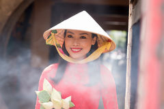 Woman in conical hat Stock Photos