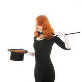 Woman conjuring with hat Royalty Free Stock Photos