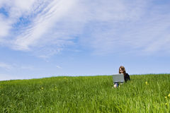 Woman Connected On The Grass Royalty Free Stock Photography