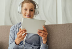 Woman connecting with a tablet Stock Images