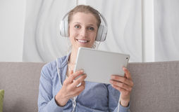 Woman connecting with a tablet Royalty Free Stock Photo