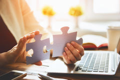 Woman connects couple puzzle piece Royalty Free Stock Images