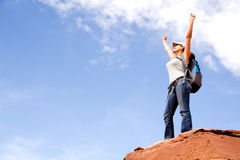 Woman conquering the world Royalty Free Stock Photo
