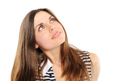 woman considers above which that Royalty Free Stock Image