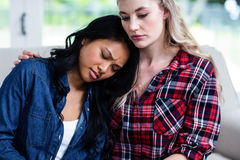 Woman consoling depressed female friend at home Royalty Free Stock Photos