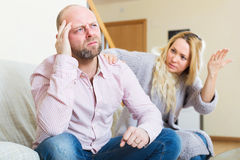 Woman consoling sad men Stock Photos