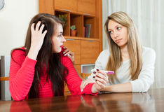 Woman consoling the worried girl with pregnancy test Stock Image