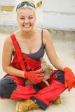 Woman on constriction site with dog stock images