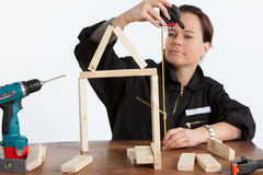 Woman constructing Stock Image