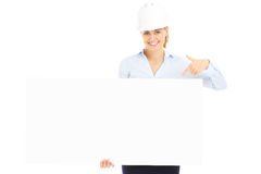 Woman with construction banner. A picture of a pretty woman in a hard hat showing an empty banner Royalty Free Stock Photography