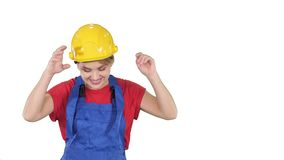 Woman in construction helmet dancing on white background. stock video footage