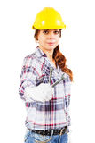 Woman in construction helmet with wrench in the right hand Royalty Free Stock Photos