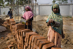Woman construction labor. Two young rural Indian women are working in a construction site Stock Photography