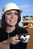 Woman at construction site Stock Photo