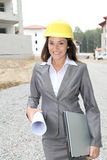 Woman on construction site Royalty Free Stock Photo