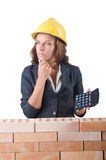 Woman construction worker with calculator Royalty Free Stock Images