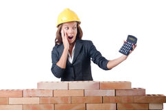 Woman construction worker with calculator Stock Image