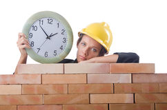 Woman construction worker with clock Stock Images