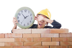 Woman construction worker with clock Stock Photos
